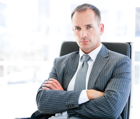 animated adult: Confident businessman looking at the camera sitting
