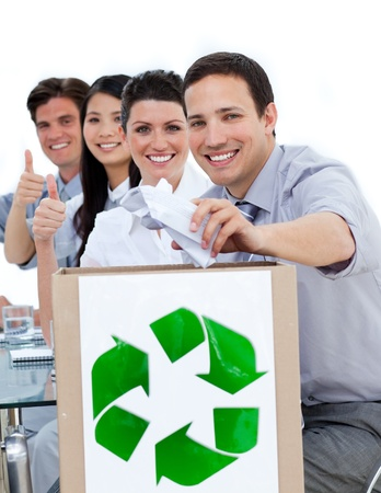 international recycle symbol: Business team with a recycle bag in the office