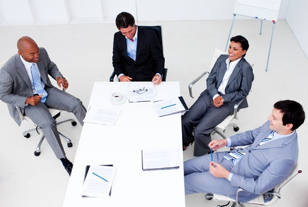 High angle of a smiling business team in a meeting photo