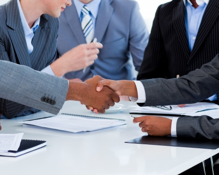Close-up of business people greeting each other Stock Photo - 10135218