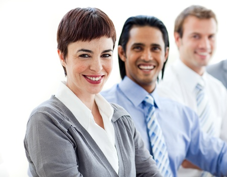 Multi-ethnic co-workers smiling at the camera  photo