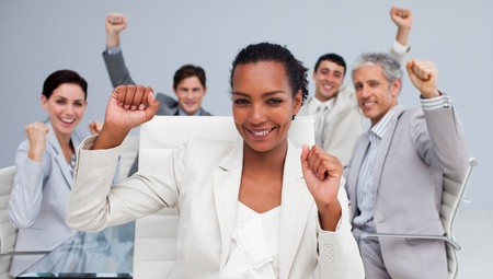 Happy multi-ethnic business team celebrating a sucess Stock Photo - 10163157
