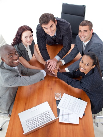 Smiling multi-ethnic business team working together photo