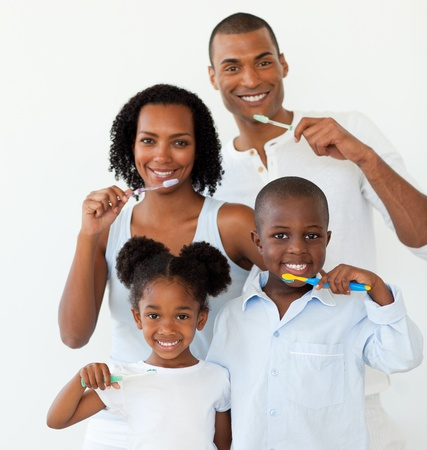 Afro-american family brushing their teeth photo