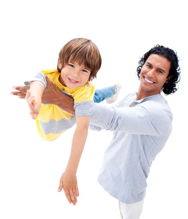 Cheerful father having fun with his son  photo