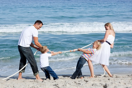 Excited family playing tug of war  photo