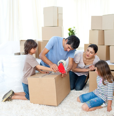 family moving house: Jolly Family moving house Stock Photo