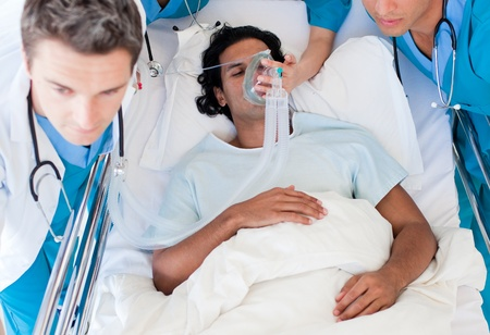 Doctors carrying a patient to intensive care unit Stock Photo - 10136638