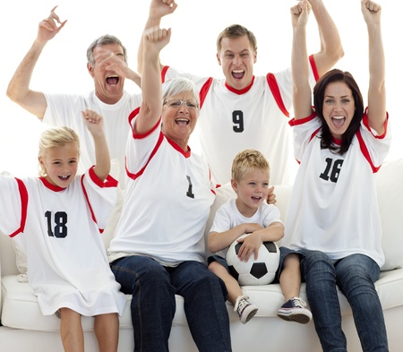 Family celebrating a goal at home photo