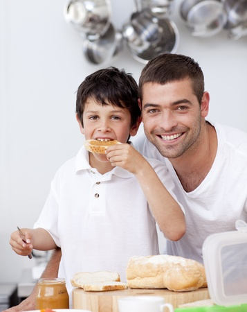 Father and son eating a toast photo