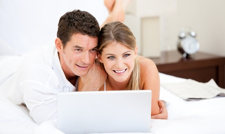 Positive couple surfing on the internet photo
