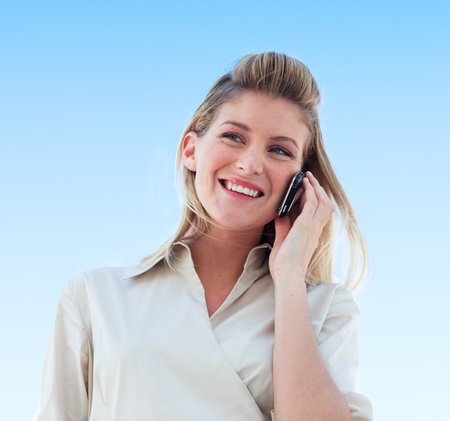 talking telephone: Beautiful businesswoman talking on the phone