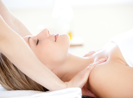 hands massage: Charming woman receiving a back massage Stock Photo