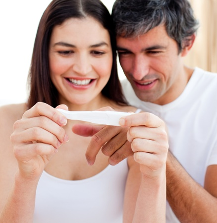 blissful: Blissful couple finding out results of a pregnancy test
