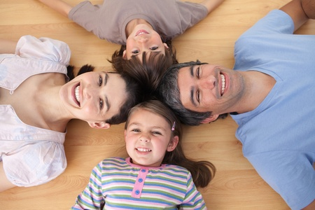 Lively family lying on the floor Stock Photo - 10175713