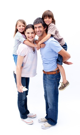 Loving parents giving their children a piggyback ride  photo