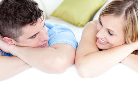 United couple looking at the camera on a sofa at home Stock Photo - 10137519