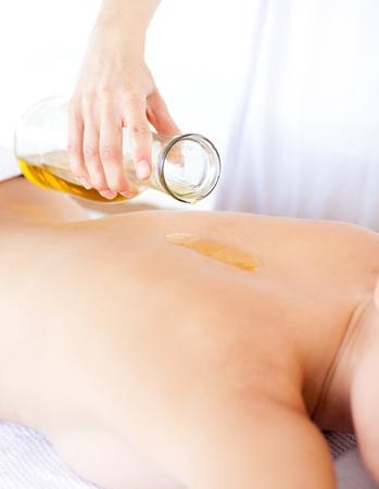 Beautiful woman having a massage with massage oil  photo