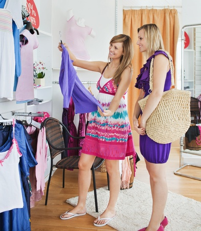 choosing clothes: Bright women choosing clothes together