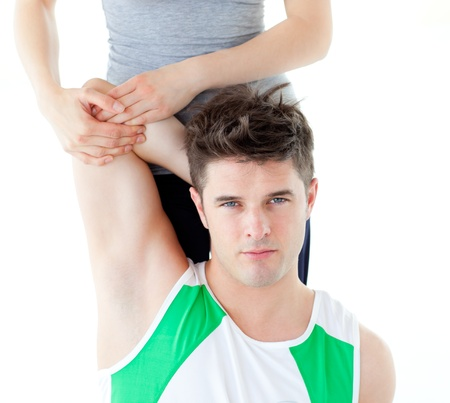 Muscular man doing fitness exercises with a woman photo