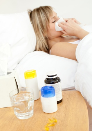 Ill woman lying in bed Stock Photo - 10136126