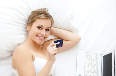 convivial: Cute woman in front of her laptop