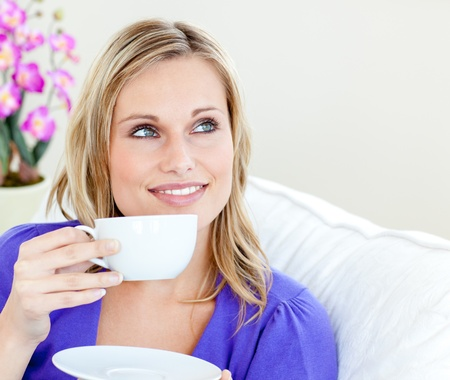 Young woman holding cup photo