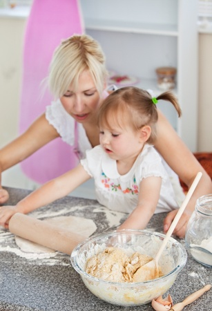 Concentrated woman baking with her daughter Stock Photo - 10175839