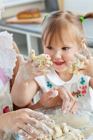 Woman baking cookies with her daughter Stock Photo - 10175907