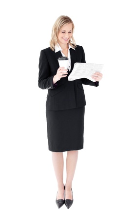 woman reading: Attractive businesswoman reading a newspaper holding a coffee