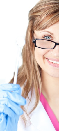 Charming female dental surgeon holding  a speculum