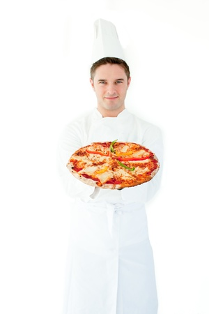 Young male cook with freshly oven-baked pizza in hand Stock Photo - 10135144