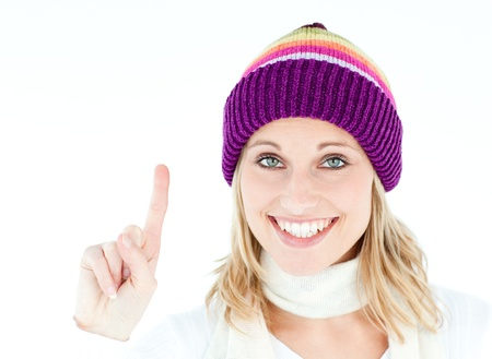 Positive woman showing up smiling at the camera against white background photo