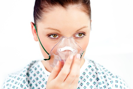 Female patient with an oxygen mask photo