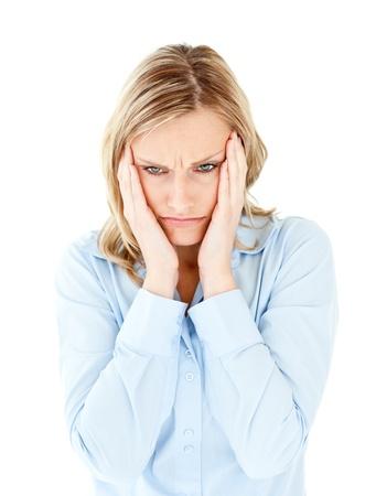 downcast: Downcast businesswoman taking her head between her hands