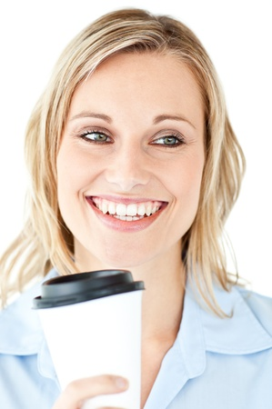 Delighted businesswoman holding a cup of coffee photo