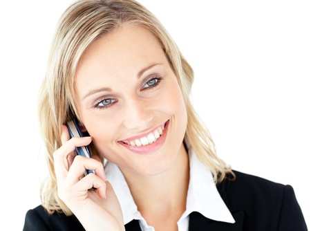 Portrait of a radiant businesswoman talking on phone photo