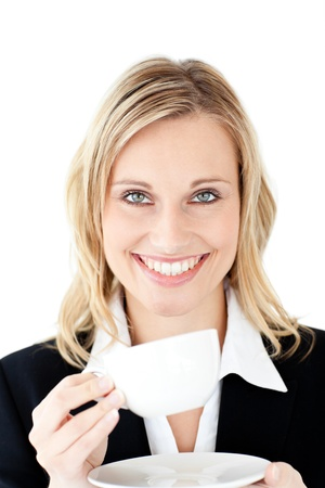 Merry businesswoman holding a cup of coffee photo
