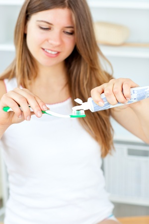 Beautiful woman using a toothbrush and toothpaste in the bathroom Stock Photo - 10137352