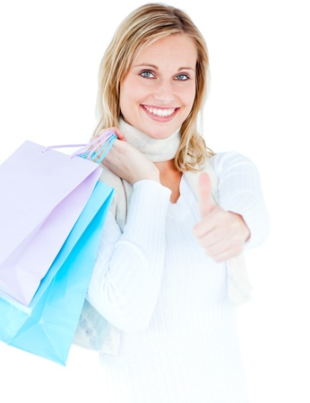 delighted: Delighted woman with thumb up holding shopping bags Stock Photo