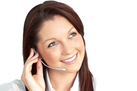 Charming young businesswoman wearing earpiece Stock Photo - 10137126
