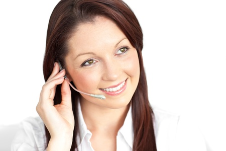 Pretty young businesswoman wearing headphones in a customer service photo