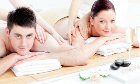 Loving young couple enjoying a back massage photo
