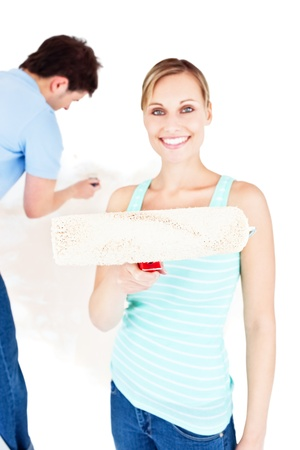Beautiful couple painting a room Stock Photo - 10162272