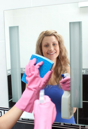 cleansed: Glowing woman cleaning a mirror