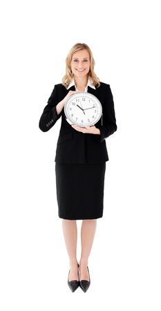 Delighted businesswoman holding a clock against white blackground Stock Photo - 10134795