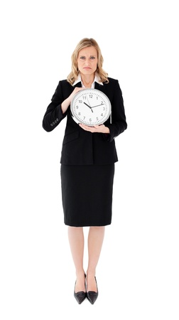 Unhappy businesswoman against white background holding  a clock Stock Photo - 10134797
