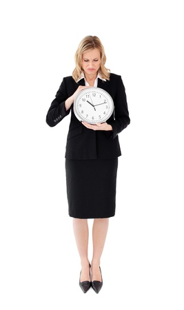 glum: Glum businesswoman holding a clock against white background