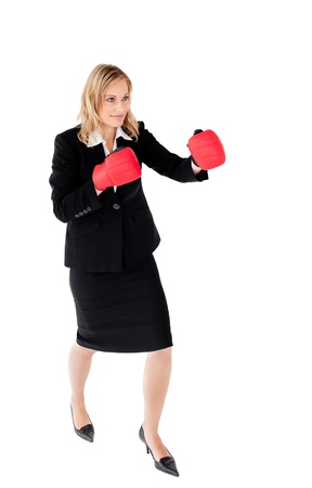 Self-assured businesswoman with red boxing gloves against white background Stock Photo - 10134981