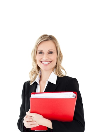 Smiling woman looking in the camera holding a red folder photo